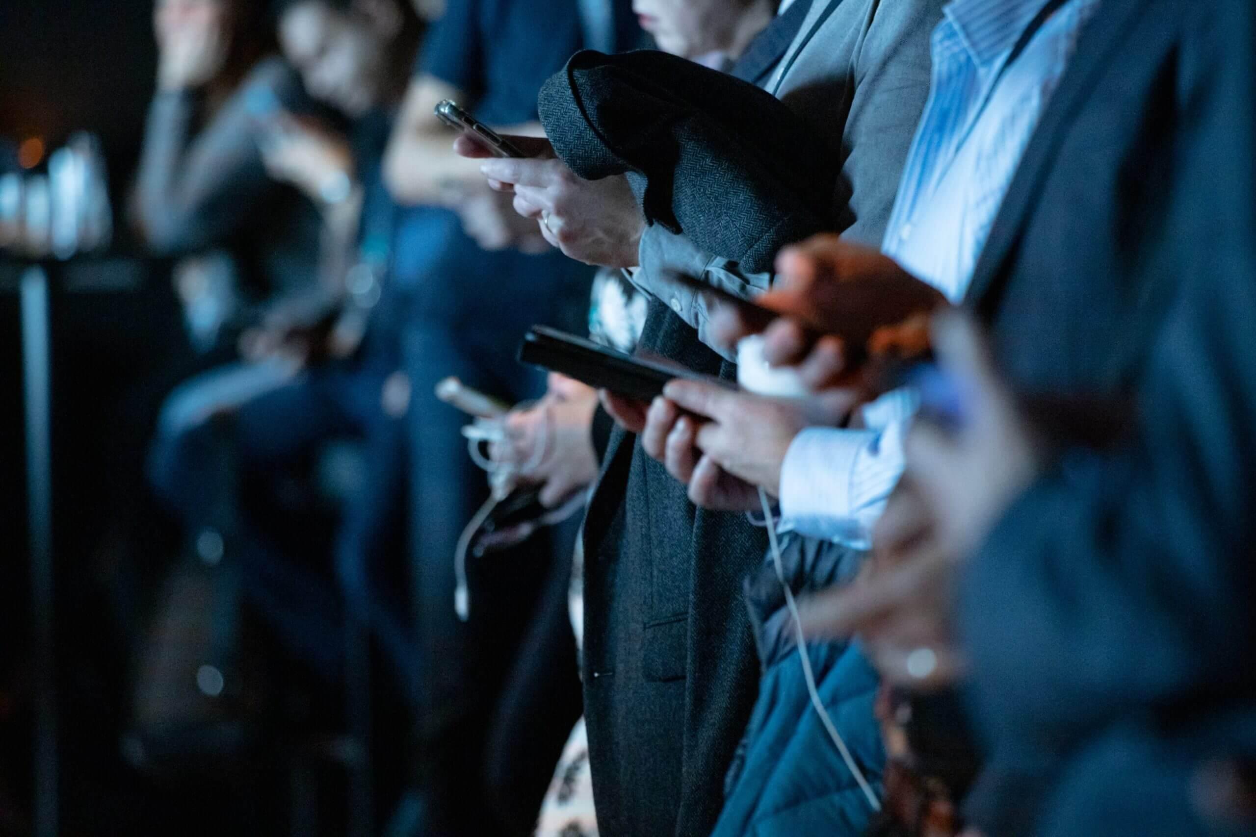 Group of men on their phones