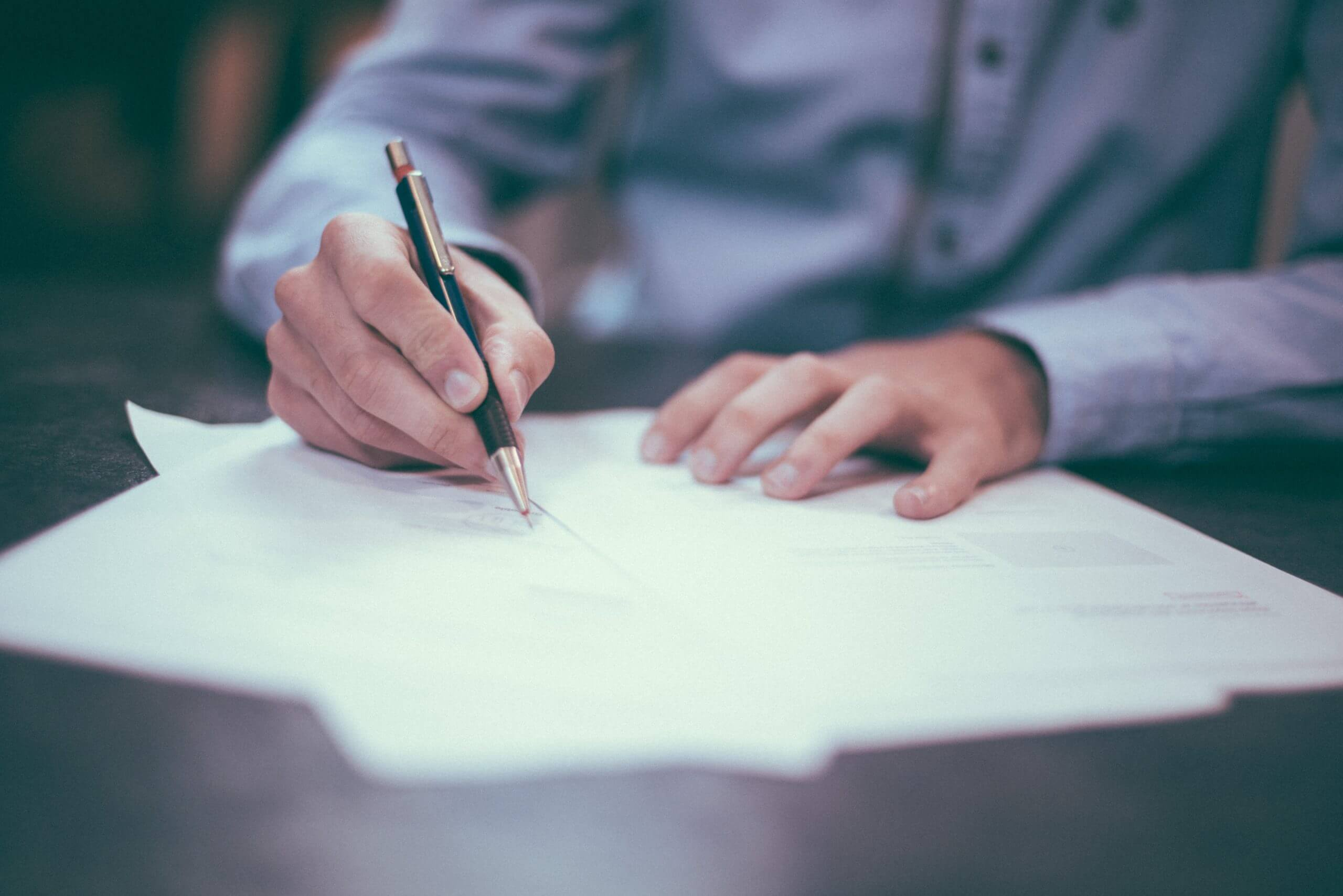 Man writing down april legislation on a piece of paper